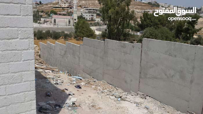 بناء الأسوار و الجدران الاستناديه و جميع المباني
