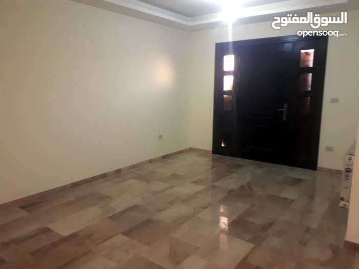 شقه أرضيه 180م للبيع في خلدا مع ترس و مدخل خاص جديده لم تسكن