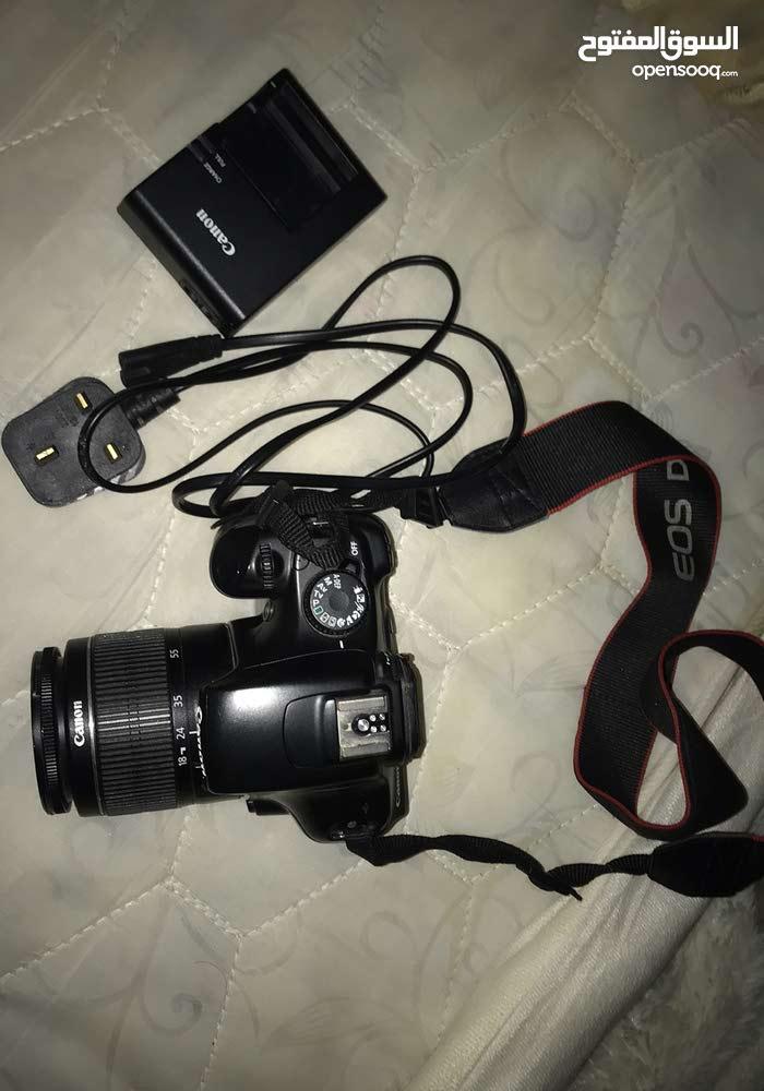 كاميرا كانون 1100 D مع جميع ملحقاته