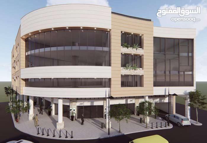 مجمع تجاري مواصفات ملكية مقابل صالة بردى على شارع بغداد و شارع الستين