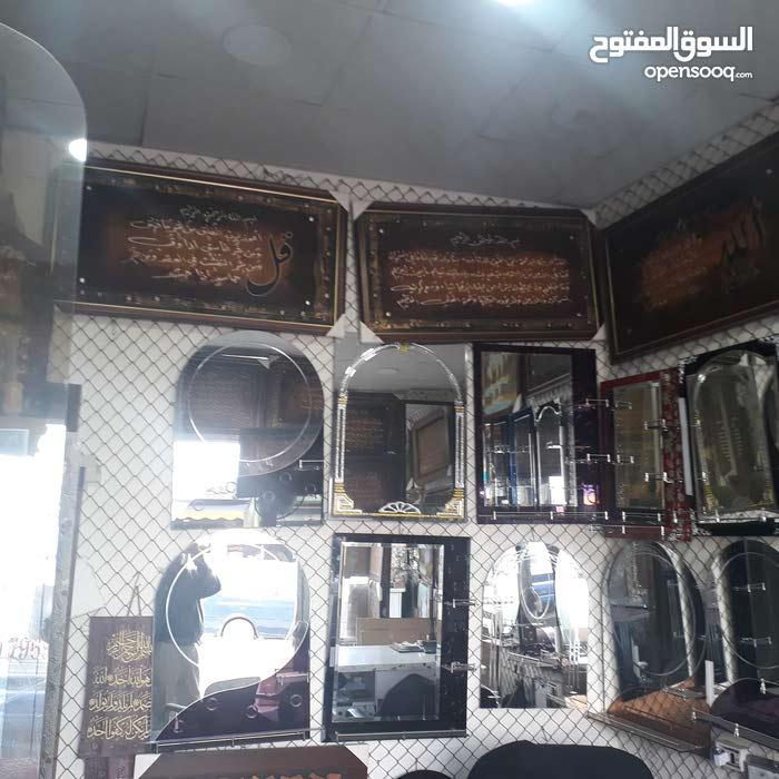 معرض ناصر حمو تركيب وبيع زجاج و مرايا