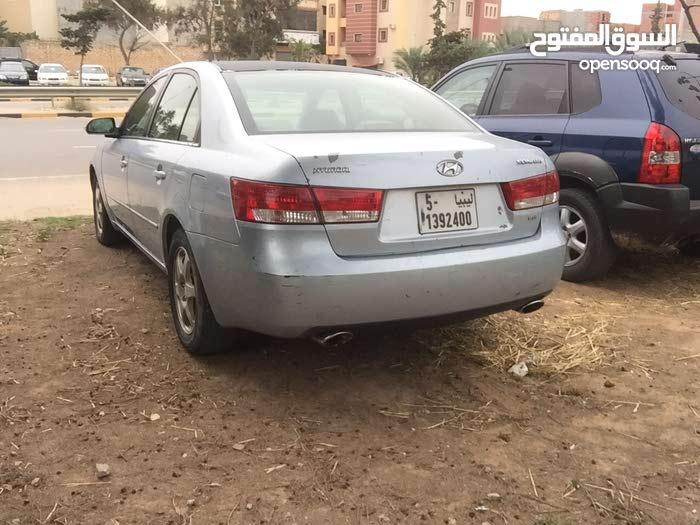 سوناتا محرك 33 السيارة ماشية 116 مايل  مكان السيارة  طرابلس سوق الجمعة