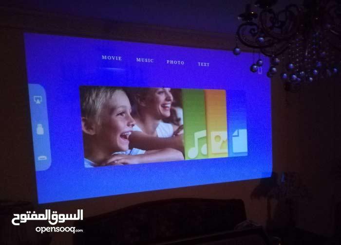Mini Projector,Vamvo 1080p HD DLP LED Rechargebale بروجكتور