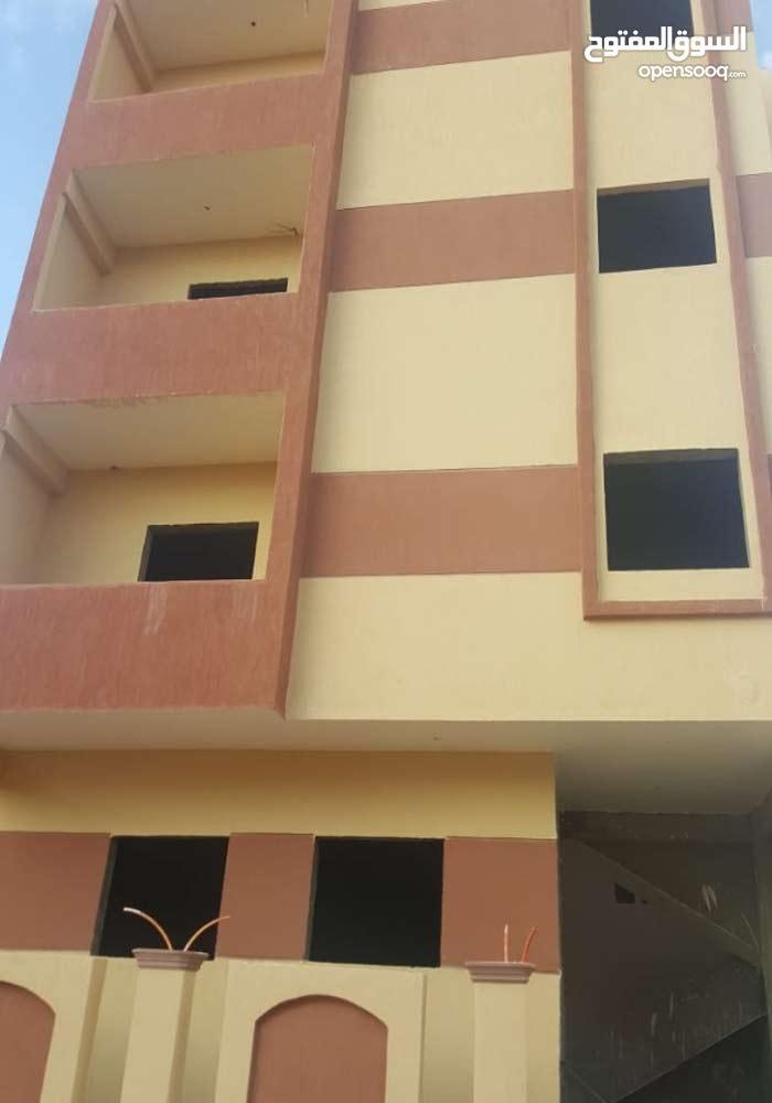 شقة بدروم و أرض & و شقة دور أول 209 م - الاسكان العائلى أمام نادى الشروق