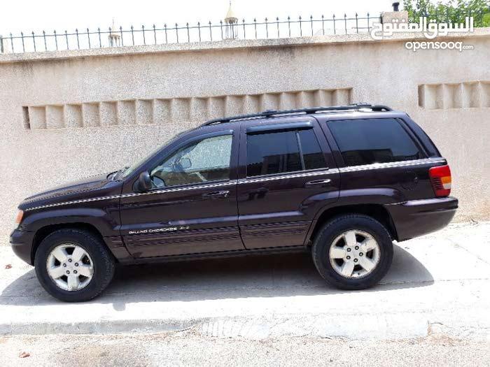 For sale 2004 Maroon Grand Cherokee