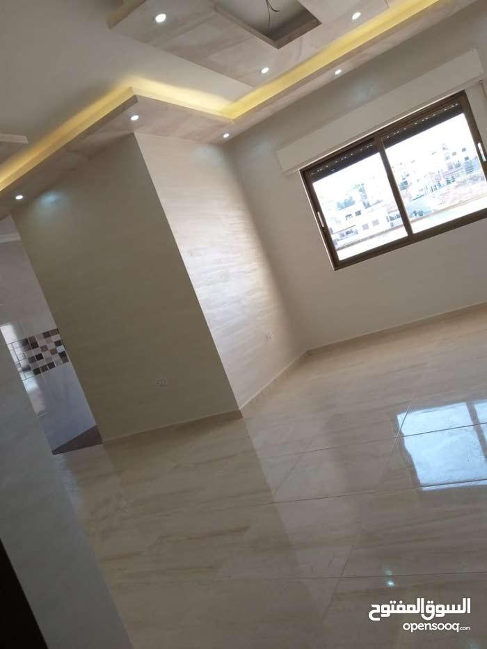 شقة للبيع بالتقسيط في طبربور __ قرب حديقة الصفا __ دون بنوك