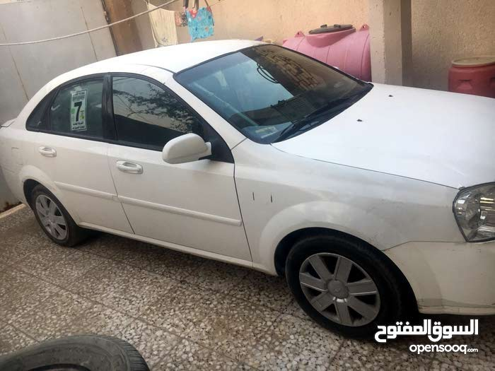 Chevrolet Optra 2011 For sale - Yellow color