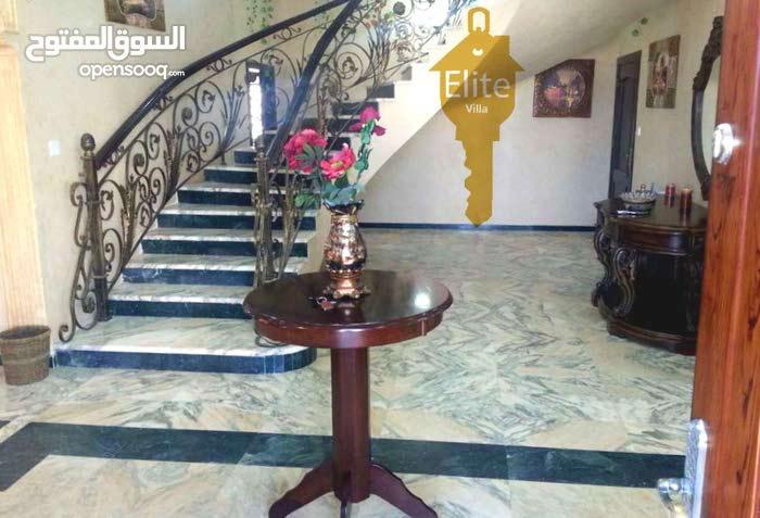 Dabouq neighborhood Amman city - 800 sqm house for sale