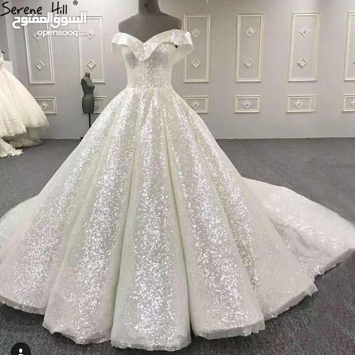 8ce8c3dd609a9 فستان زفاف فخم ولامع - (103354588)