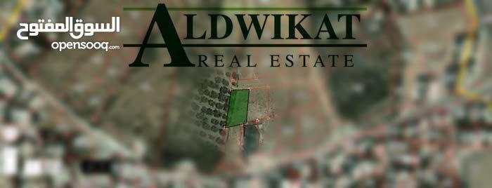 قطعة ارض للبيع في منطقة صافوط بمساحة 990 متر