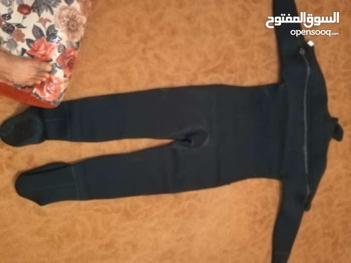 بدلة غطس لون أسود  صناعة أمريكية خامة ممتازة شتويه بدون رزنات