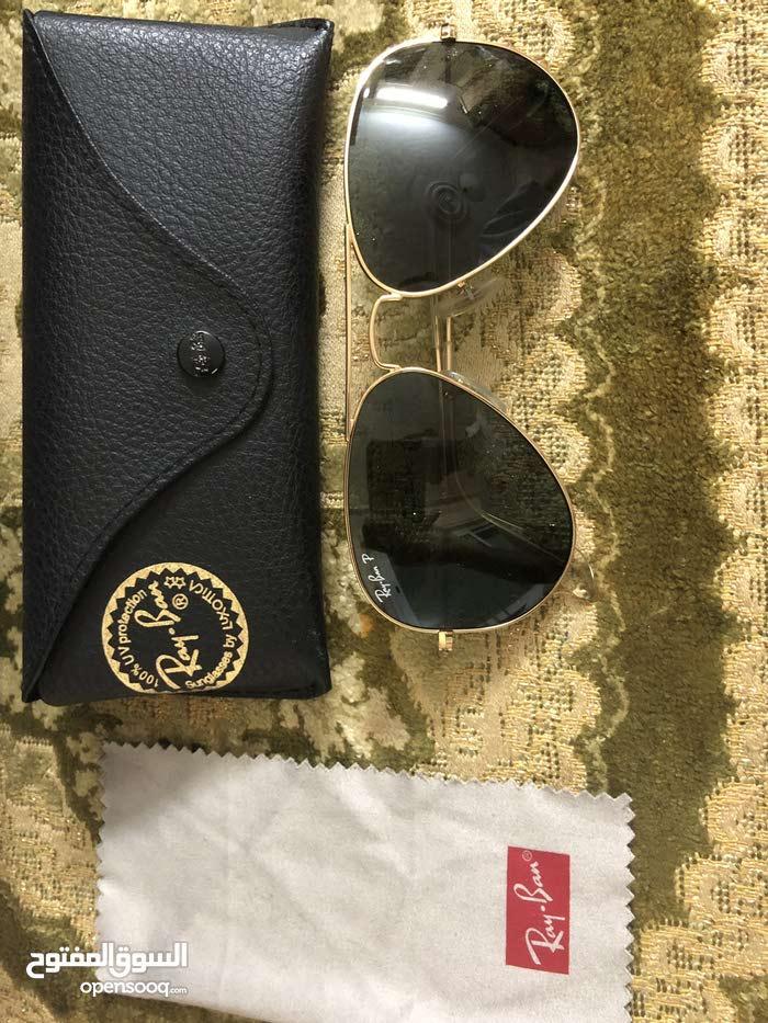 50a13b9e8 نظارات راي بان ذهبي اصليه، مقاس 55، ايطالية الصنع - (106975034)   السوق  المفتوح