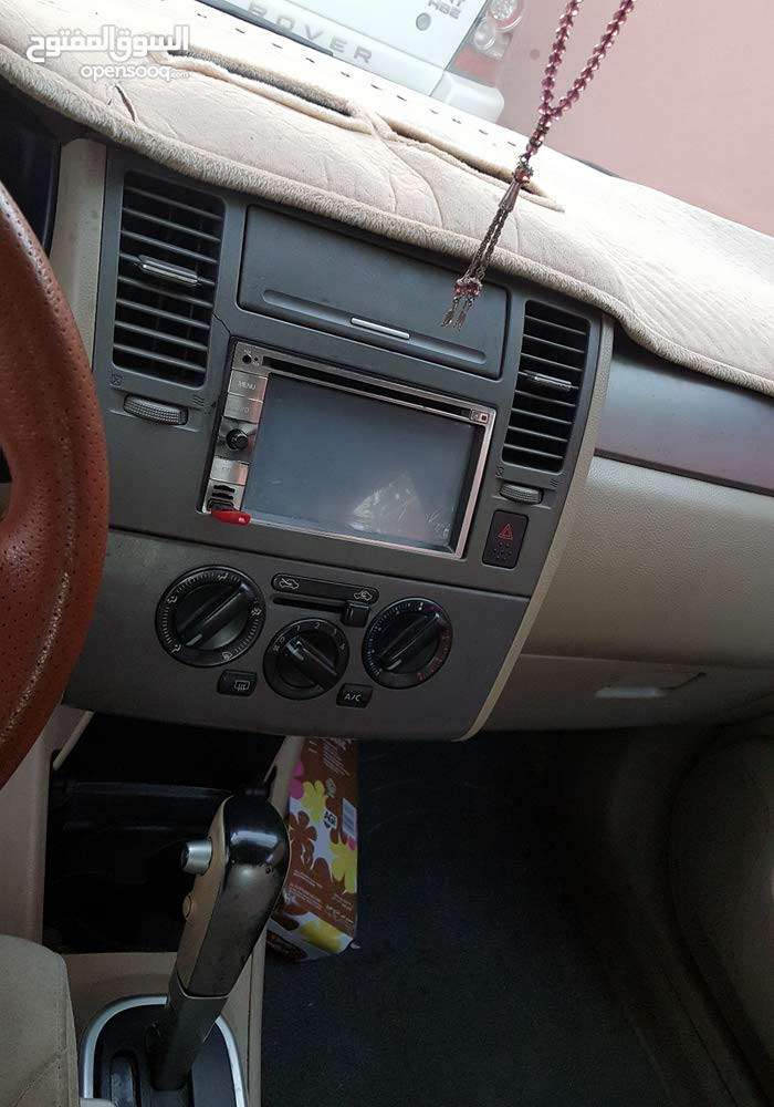 Used condition Nissan Tiida 2008 with +200,000 km mileage