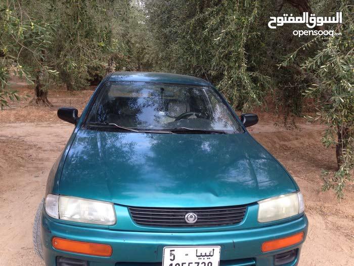 Green Mazda 323 1999 for sale