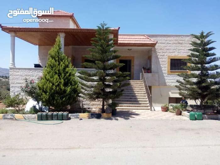 عمارة طابقين للبيع في منطقة سيحان / السلط