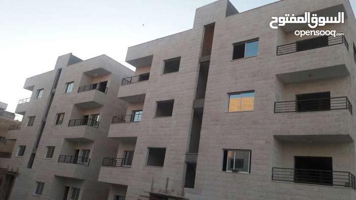 شقة 125م مع روف 60م في اول جبل الحديد