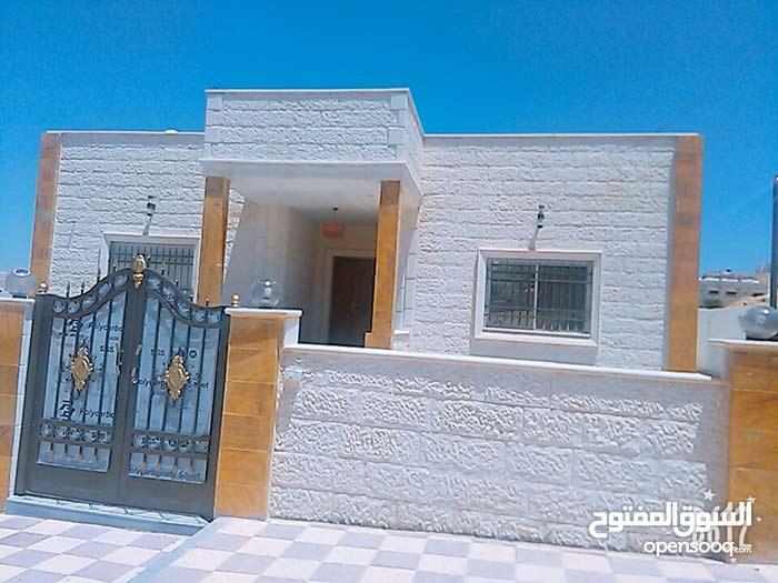 Dahiet Al Madena Al Monawwara neighborhood Zarqa city - 200 sqm house for sale