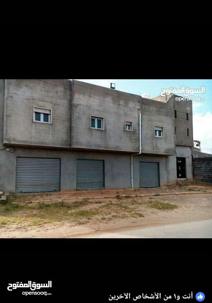 منزل في تاجوراء كوبري شاحنات شارع ضمان مساحة 300مسقوف 175م