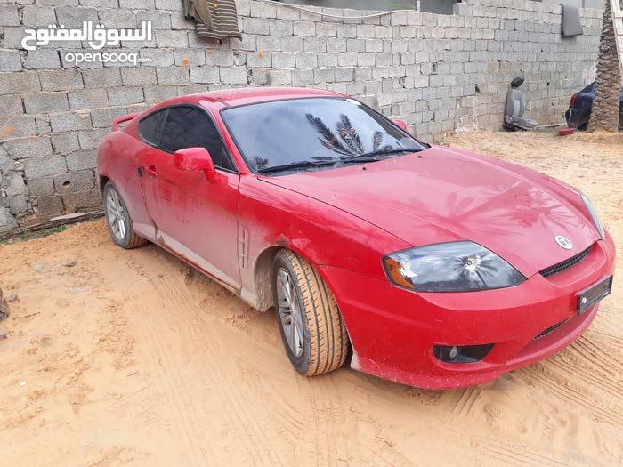 هونداي توسكاني لون احمر كمبيو عادي ماشية 149 للبيع المستعمل ييارة شبه جديدة