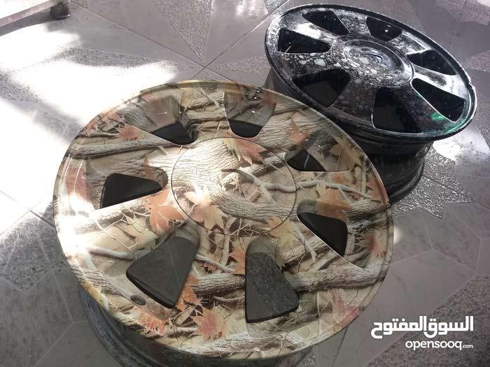 تلبيس مائي على كافة انواع الجنوطة والتابلويات وقطع المتور والسيارة