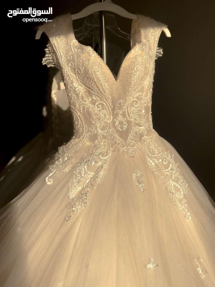 New Low-priced wedding dress...فستان زفاف جديد للبيع بسعر مميز