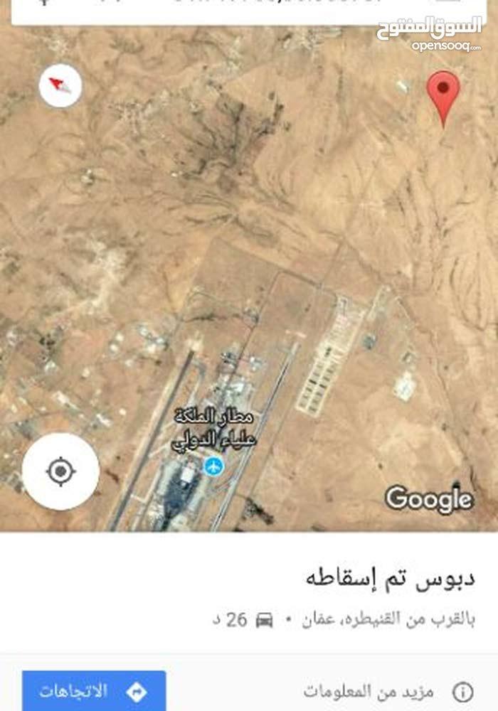 ارض للبيع في القويره خلف المطار