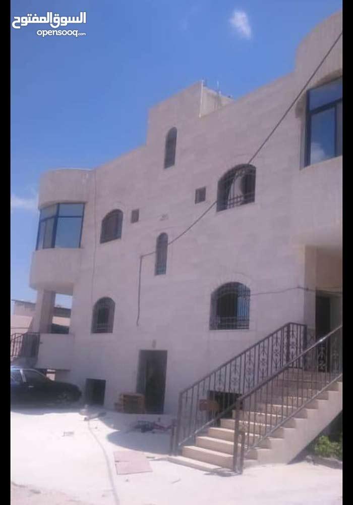 مادبا، عمارة سكنية، حي الكرامة