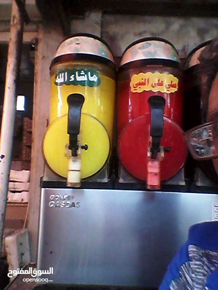 ماكينة عصير نوع دمبر  وماكينة بوظة oceanpower وفريزر وثلاجة وطاولة مع سخان للشاي
