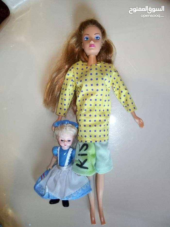 Couple: (Barbie original Mother Mattel or Symba + a Baby) like new condition.