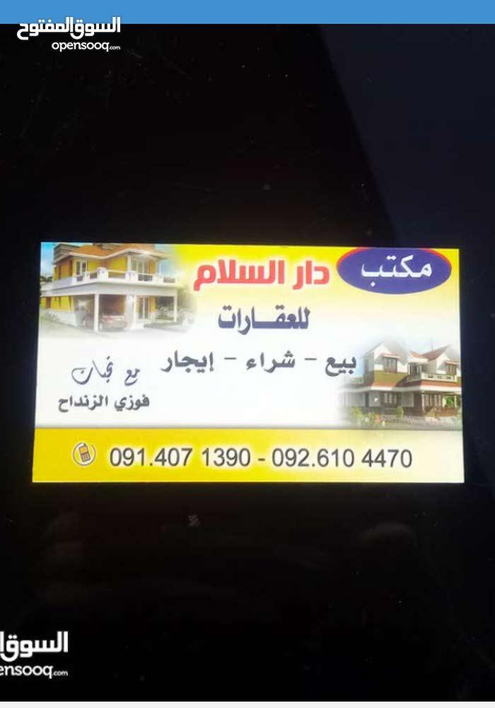 محل تجاري للايجار على الرئيسي  من دورين في زاوية الدهماني
