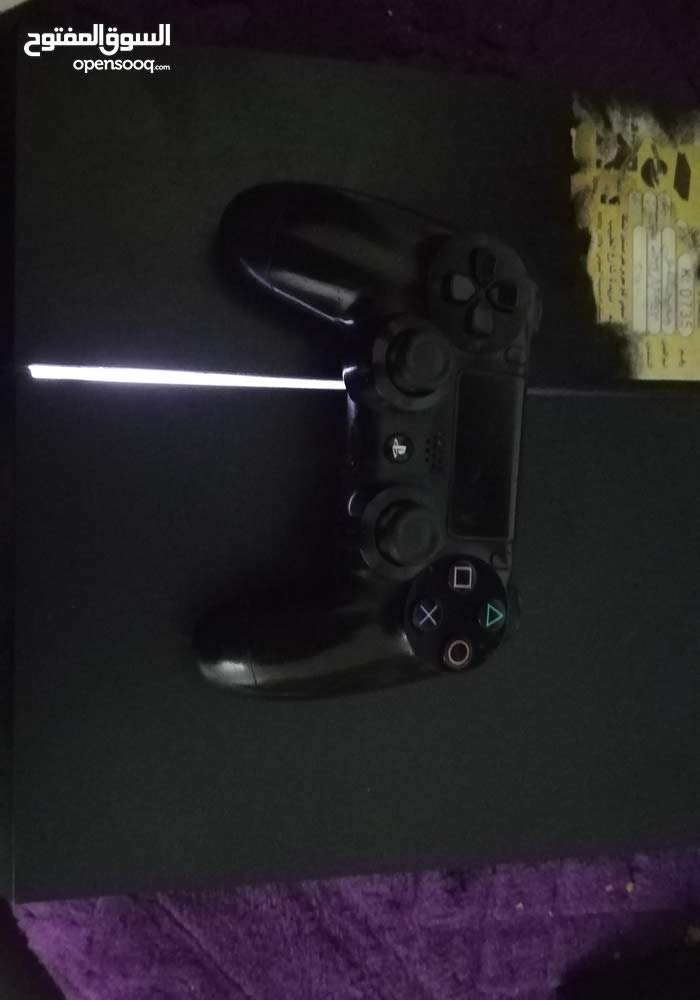 Used Playstation 4 device with add ons for sale today