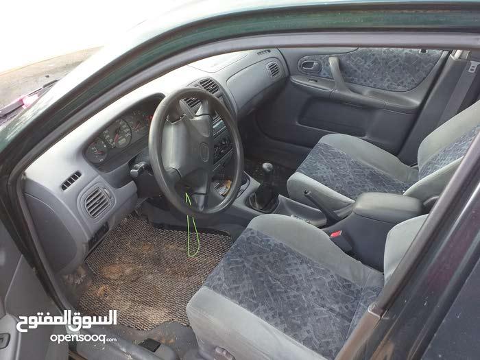 Green Mazda 323 2000 for sale