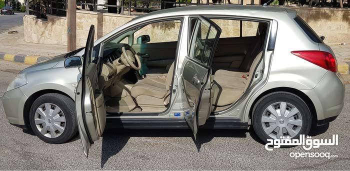 سيارة نيسان تيدا 2008 للبيع بسعر 3500 دينار اردني (نمرة صفراء) لون شامبين بيج جمارك غير مدفوعة