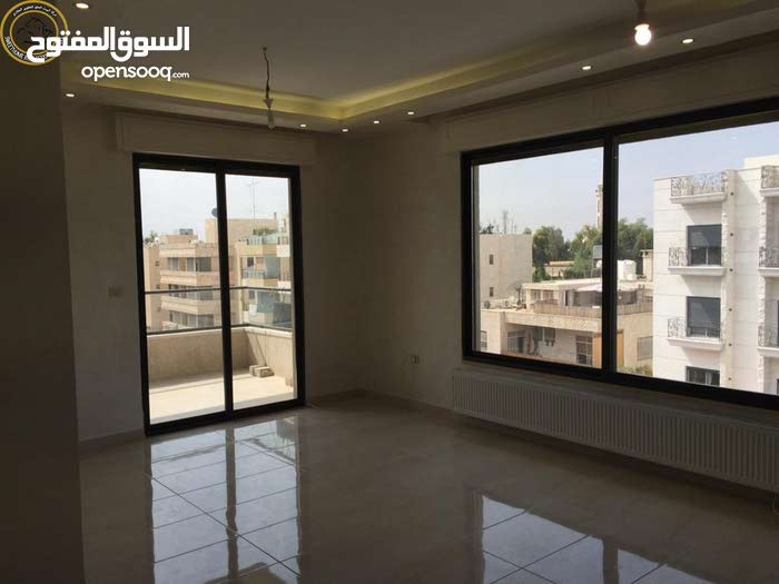 Al Jandaweel neighborhood Amman city - 225 sqm apartment for sale