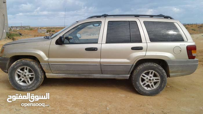 Gold Jeep Laredo 1999 for sale