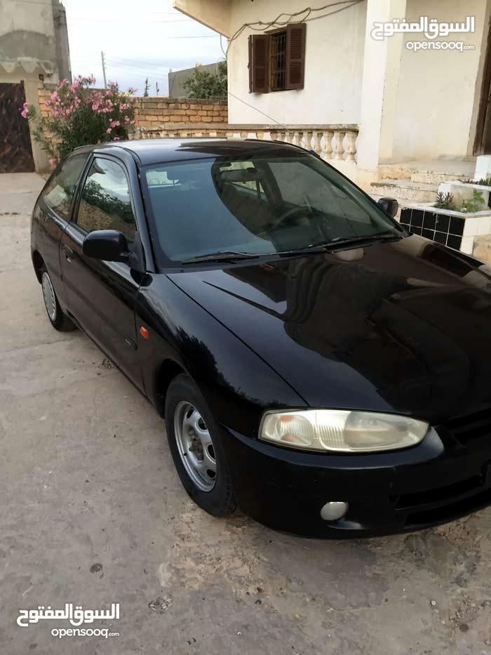 Mitsubishi Colt 2002 - Tripoli