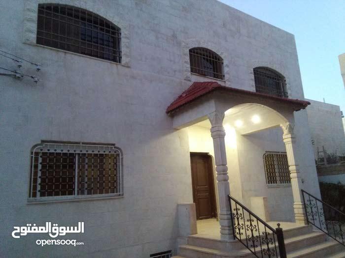 عماره من طابقين وتسويه عدد 2 للبيع  في مرج الحمام / للاستثمار او السكن
