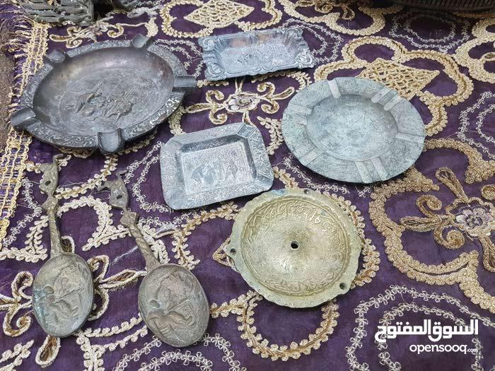 4مكتات سجائر فرعونيات وملعقتين اثار نحاس صب