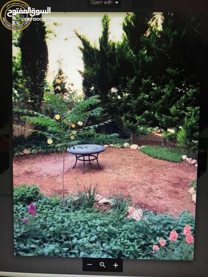 شقة ارضية مميزة للبيع في تلاع العلي 165م مع حديقة وترسات 150م