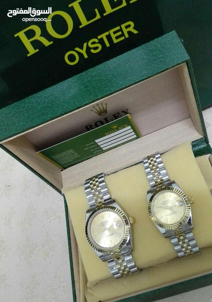 f3d23bb03dfe9 طقم ساعة رولكس نسائي رجالي حديد - (104083612)