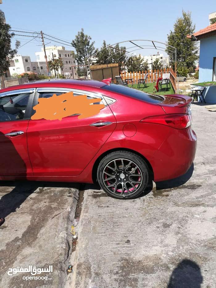 Hyundai Avante 2011 For Rent - Maroon color