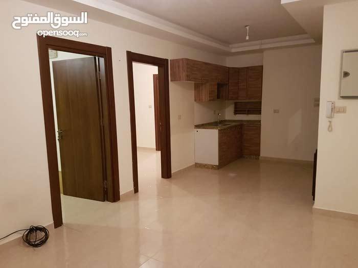 شقة فارغة للايجار خلف الماك شارع عبدالله غوشة جديد لم تسكن