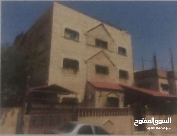 عمارة \ منزل مستقل للبيع عن طريق المزاد العلني في الهاشمي الشمالي