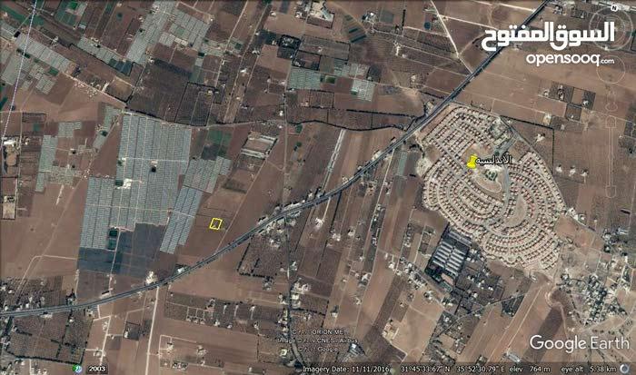 ارض للبيع طريق عمان مادبا مقابل الاندلسيه مساحه 5100م