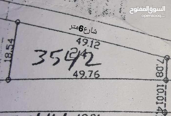 قطعه ارض للبيع الهاشميه الاسكان ثلاث شوارع واصل جميع الخدمات سعر المتر 40 دينار