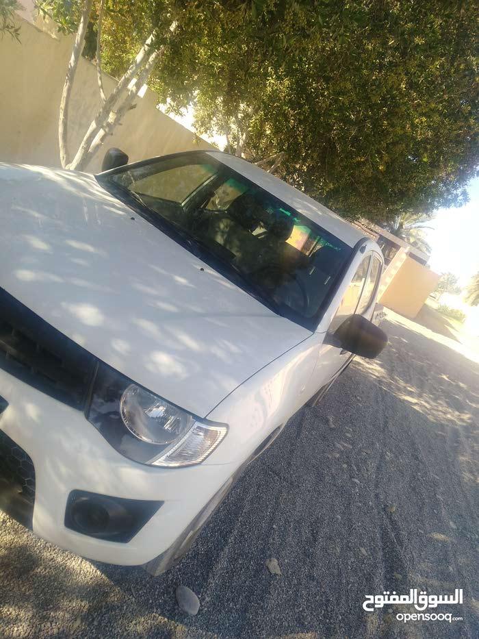 White Mitsubishi Pickup 2014 for sale