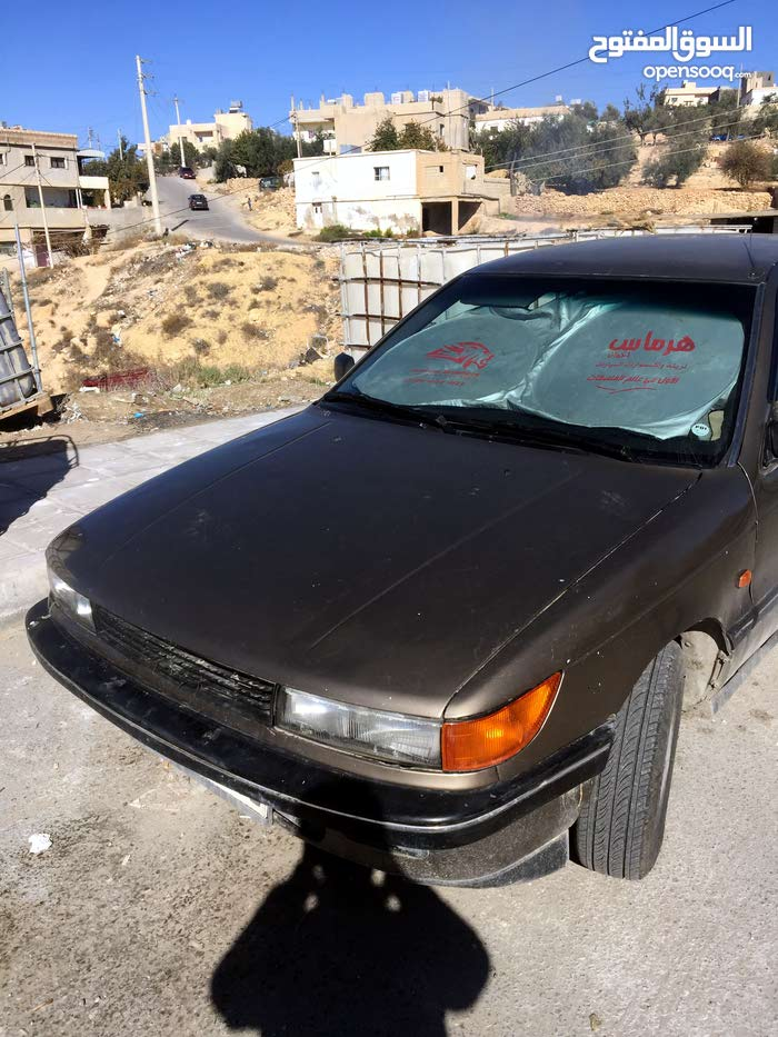 Brown Mitsubishi Lancer 1990 for sale