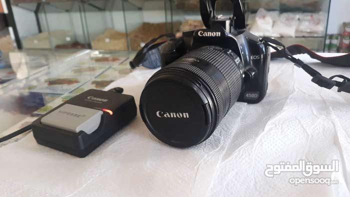 كاميرا كانون D450 معاها العدسه وملحقاتها