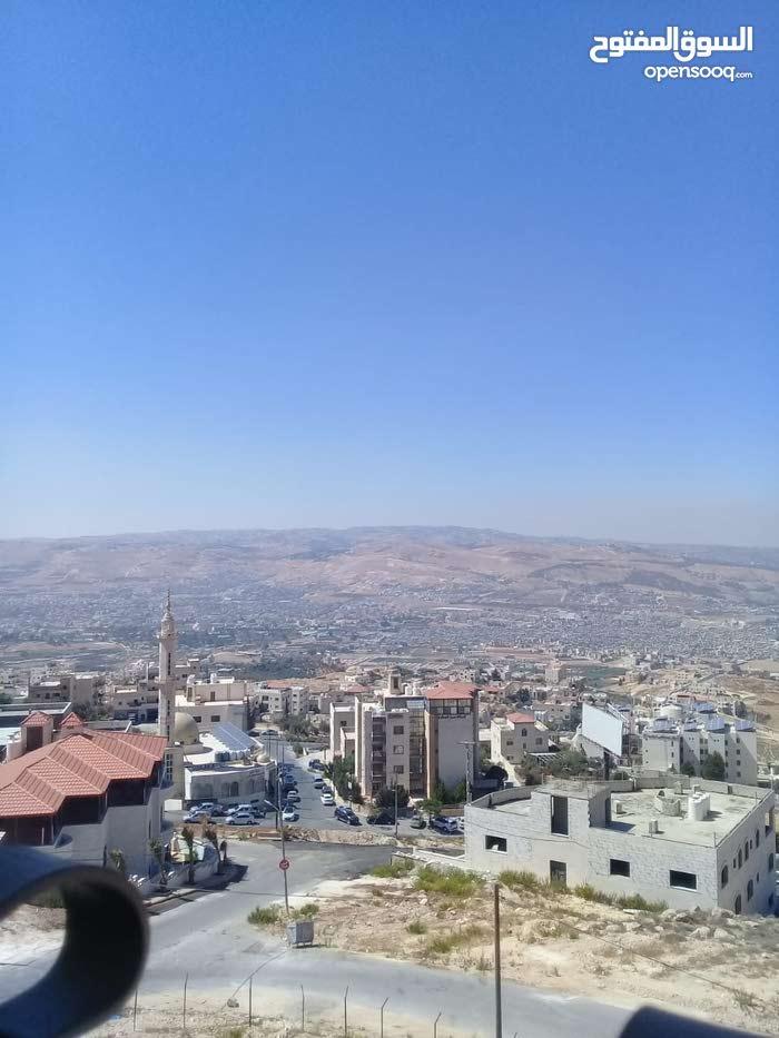 بالتقسيط باجمل منطقة بابو نصير محاطة بالفلل بجانب صحارى مول
