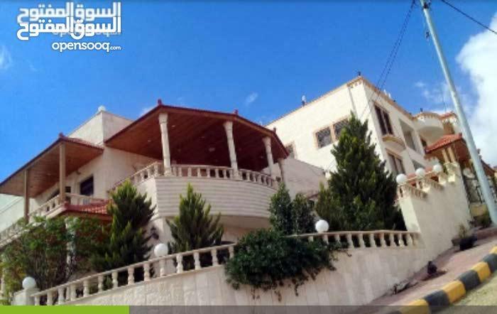 Dahiet Al Madena Al Monawwara neighborhood Zarqa city - 370 sqm house for sale